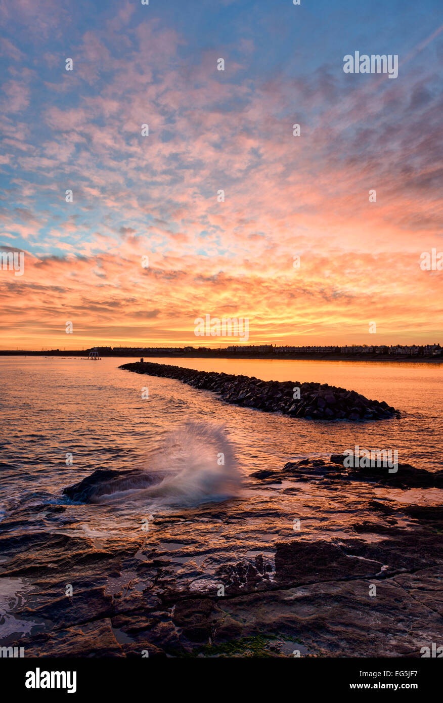 Sunset at Newbiggin by the Sea - Stock Image