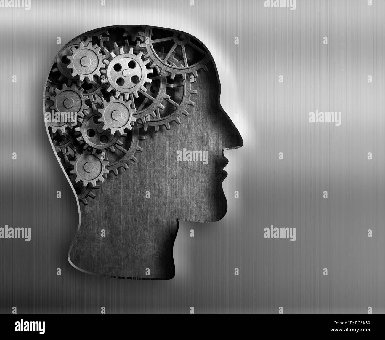 Brain model from gears and cogs in metal plate. - Stock Image