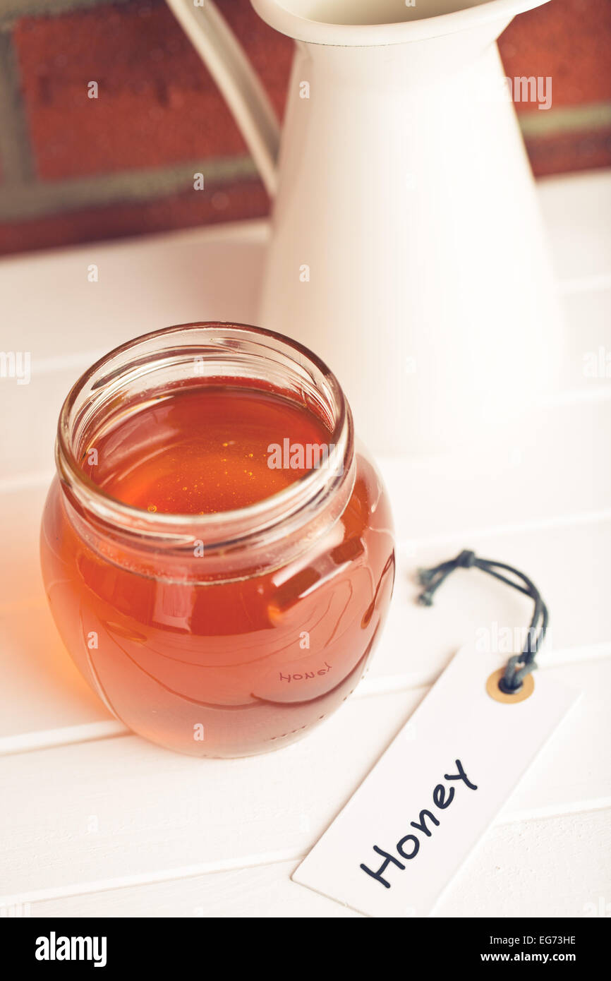 the honey in jar and label - Stock Image