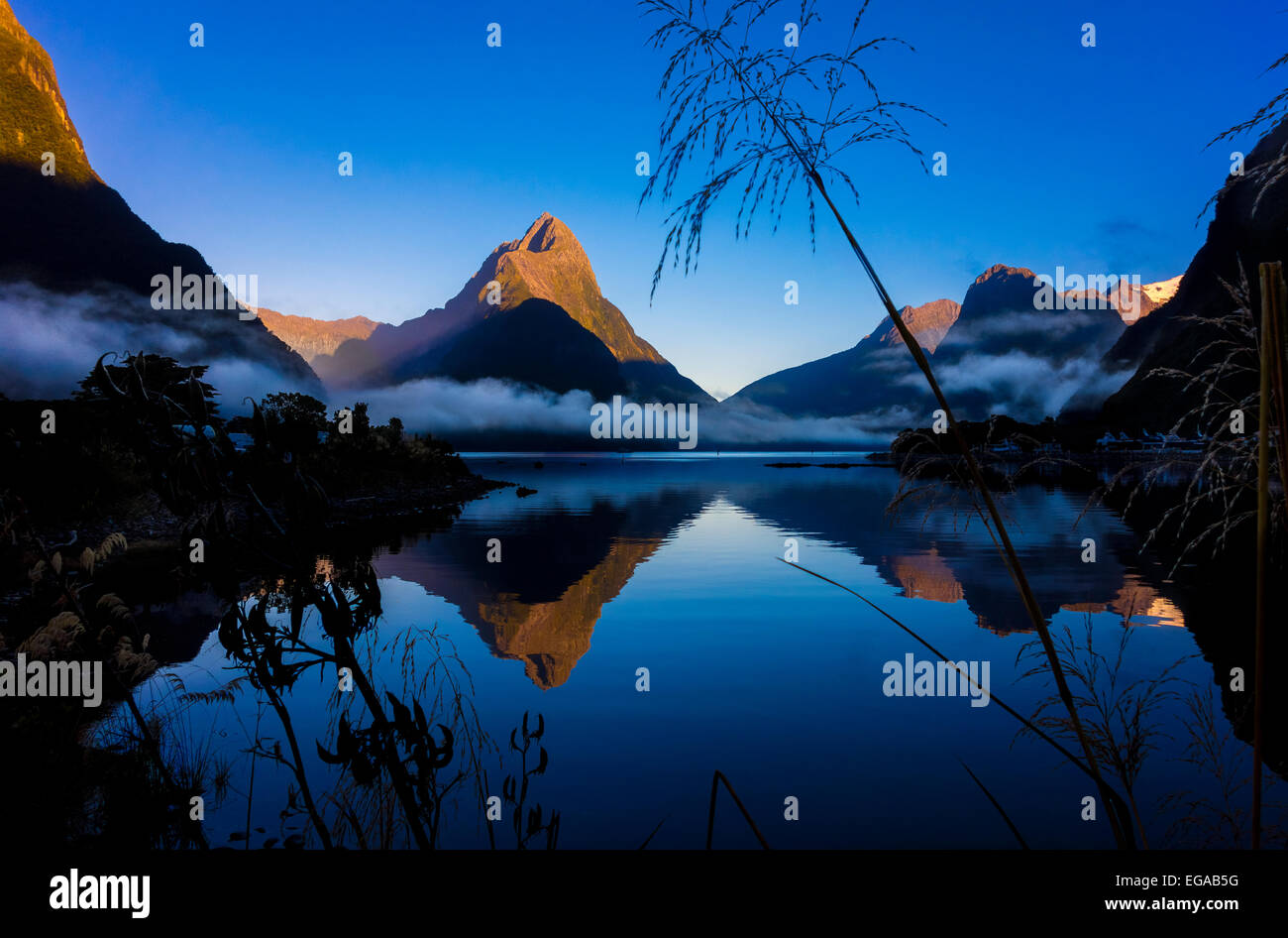 New Zealand Milford Sound with Mitre Peak in Fiordland National Park New Zealand at dawn Stock Photo