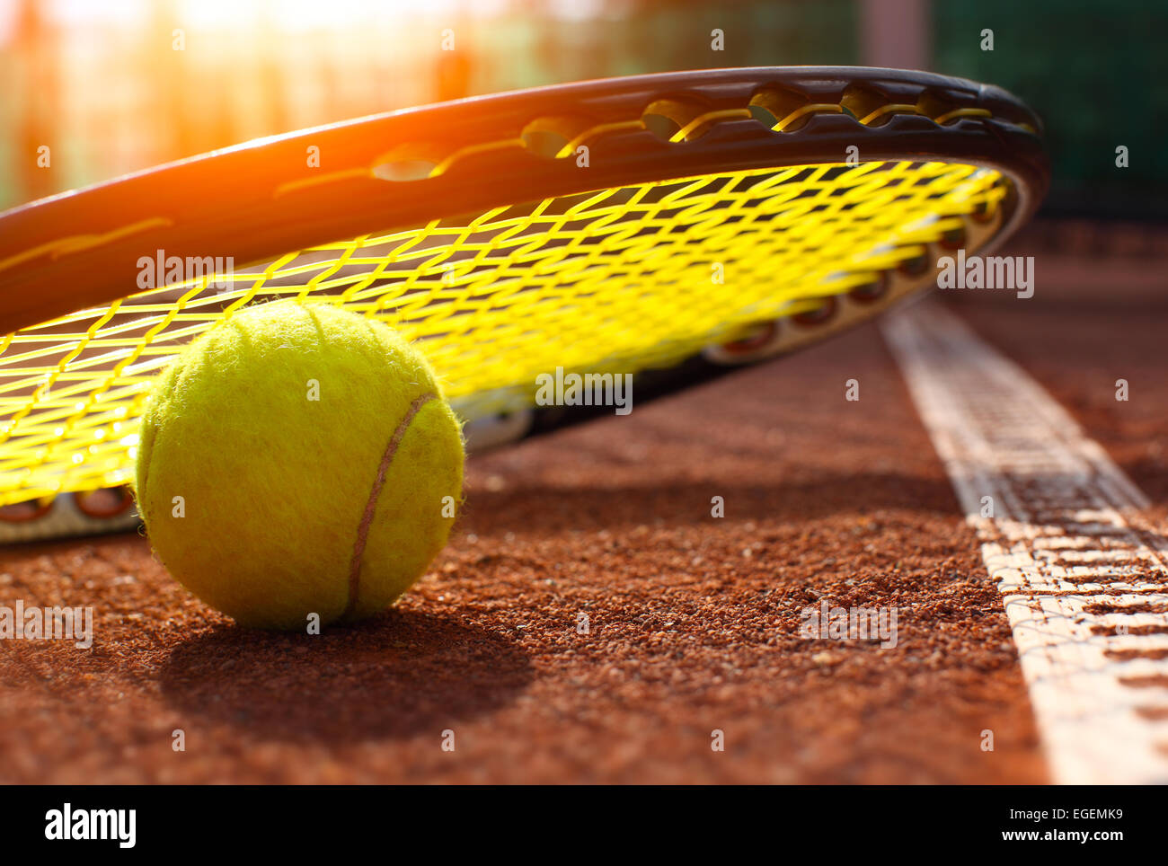tennis ball on a tennis court - Stock Image