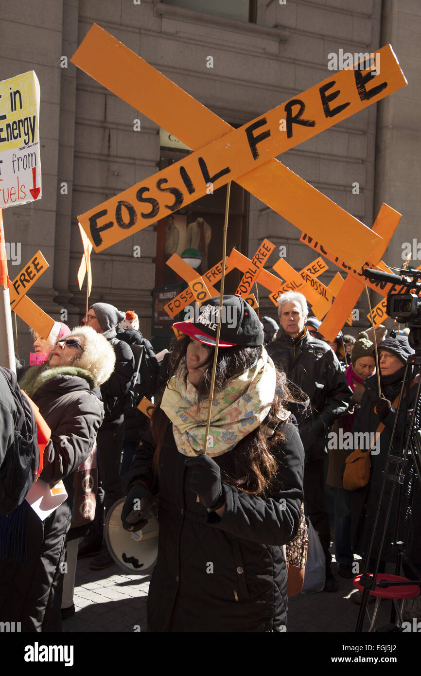 Demonstrators rally in the financial district near the NY Stock Exchange with the message for funds to divest from - Stock Image