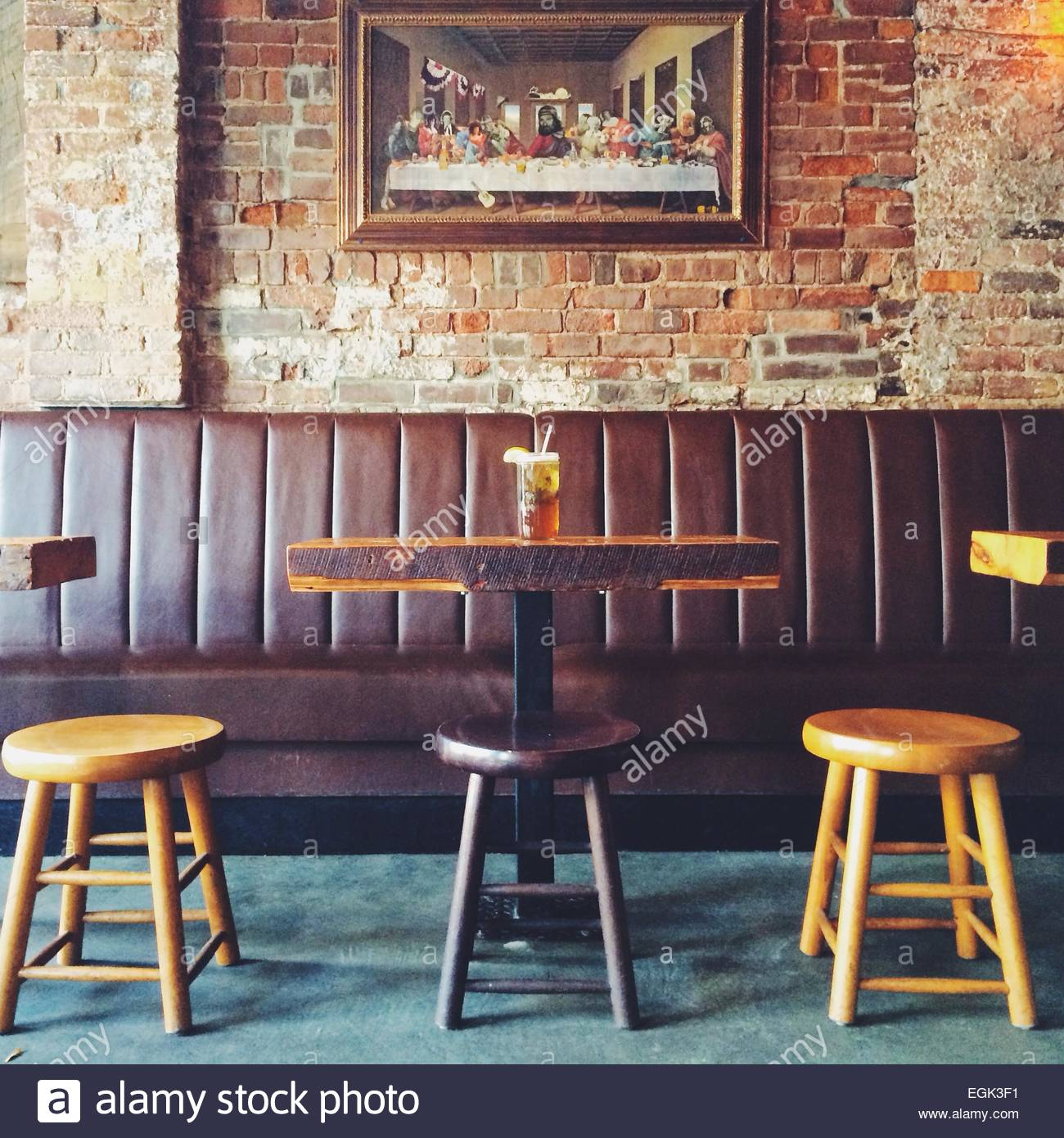 Pub table and stools with The Last Supper in background Stock Photo
