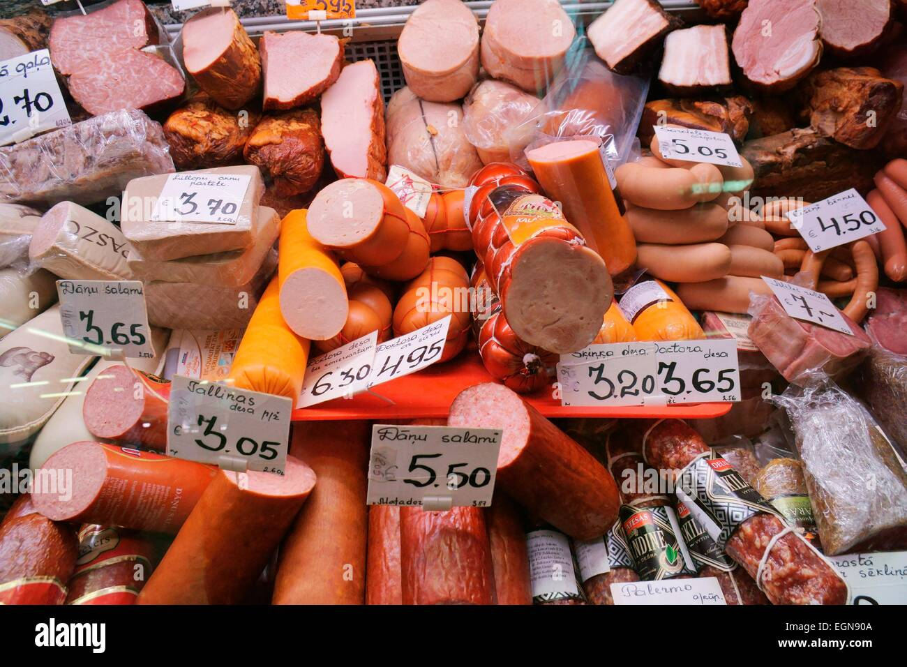Riga Latvia. Varieties of cured sausage salami pressed meat in the Centraltirgus, largest food market in the Baltic - Stock Image