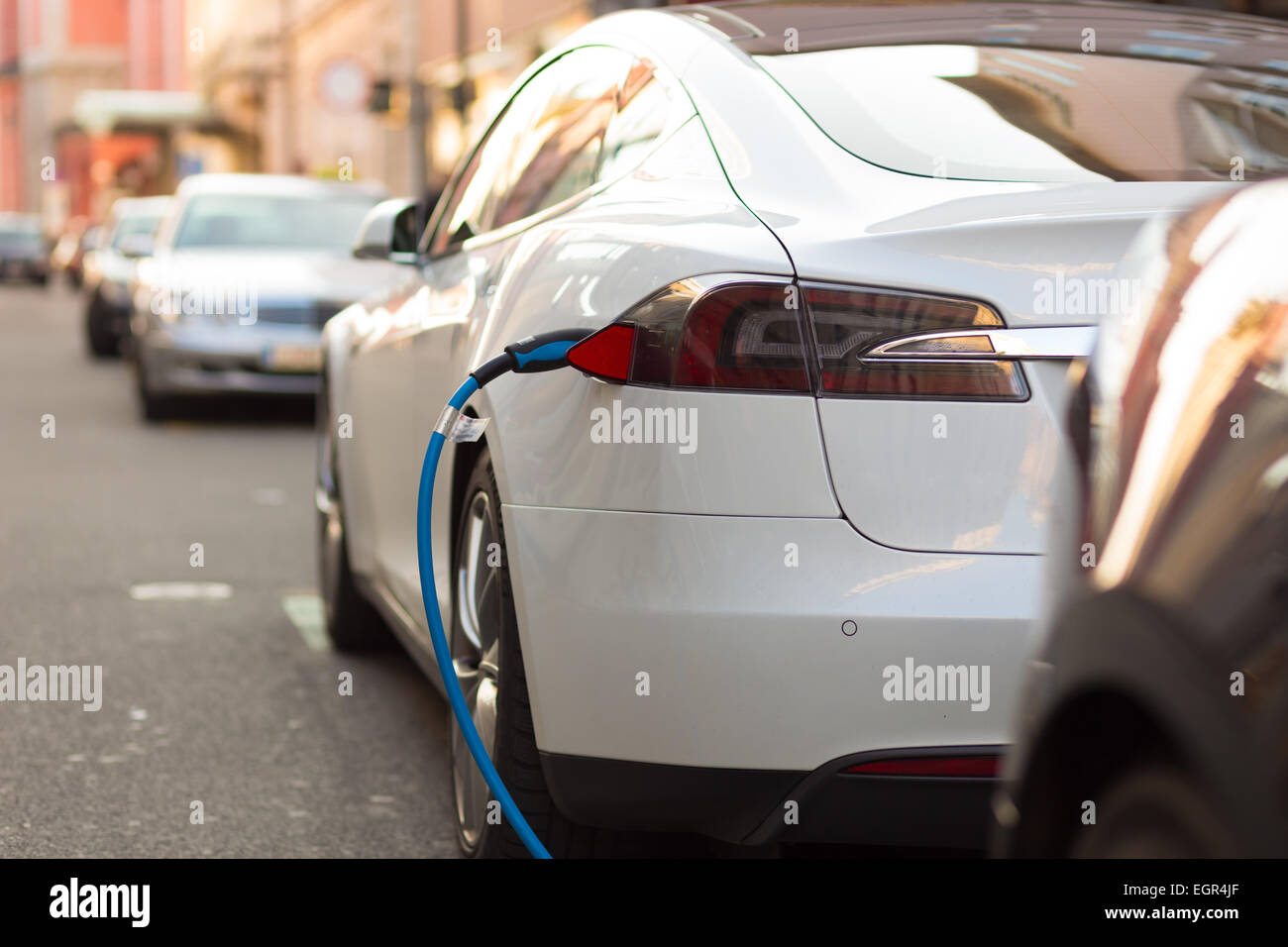 Electric Car in Charging Station. - Stock Image