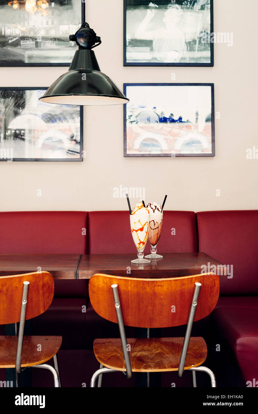 Glasses of ice creams served on restaurant table Stock Photo