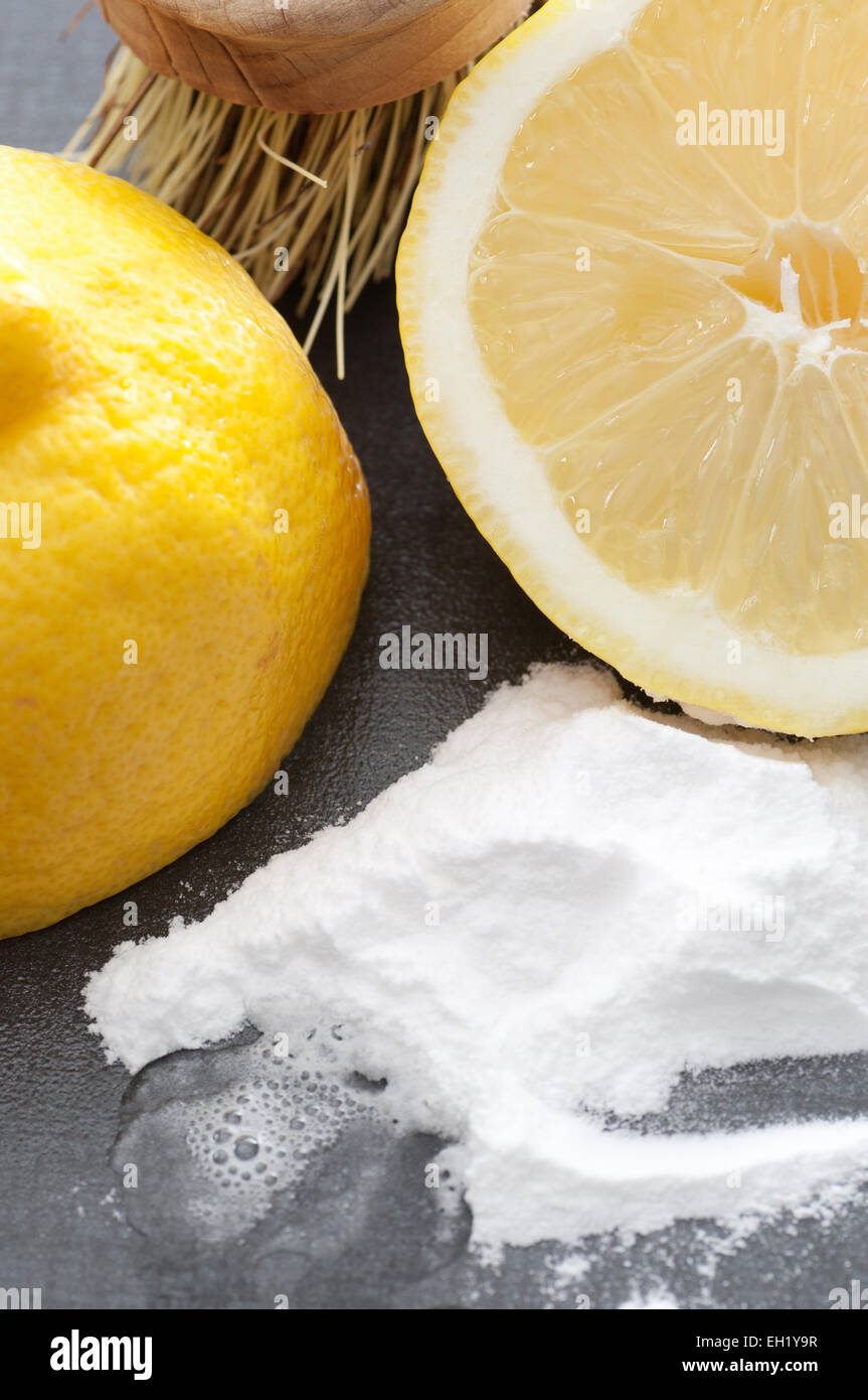Baking soda, lemon and a brush. Environmentally friendly cleaning ingredients. - Stock Image