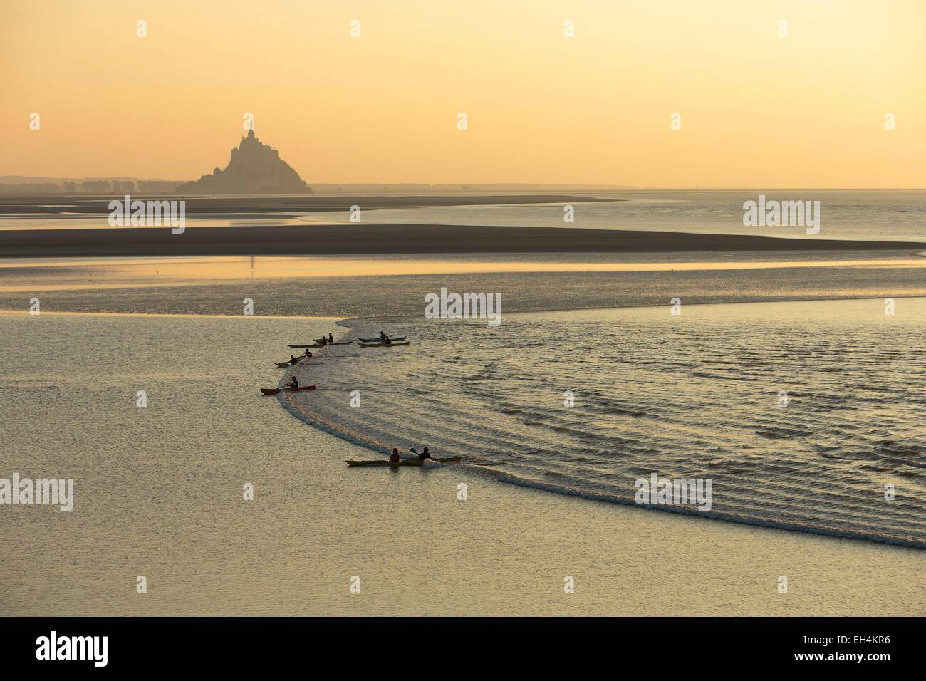 France, Manche, Mont Saint Michel bay, listed as World Heritage by UNESCO, a kayakists riding the Mascaret wave - Stock Image