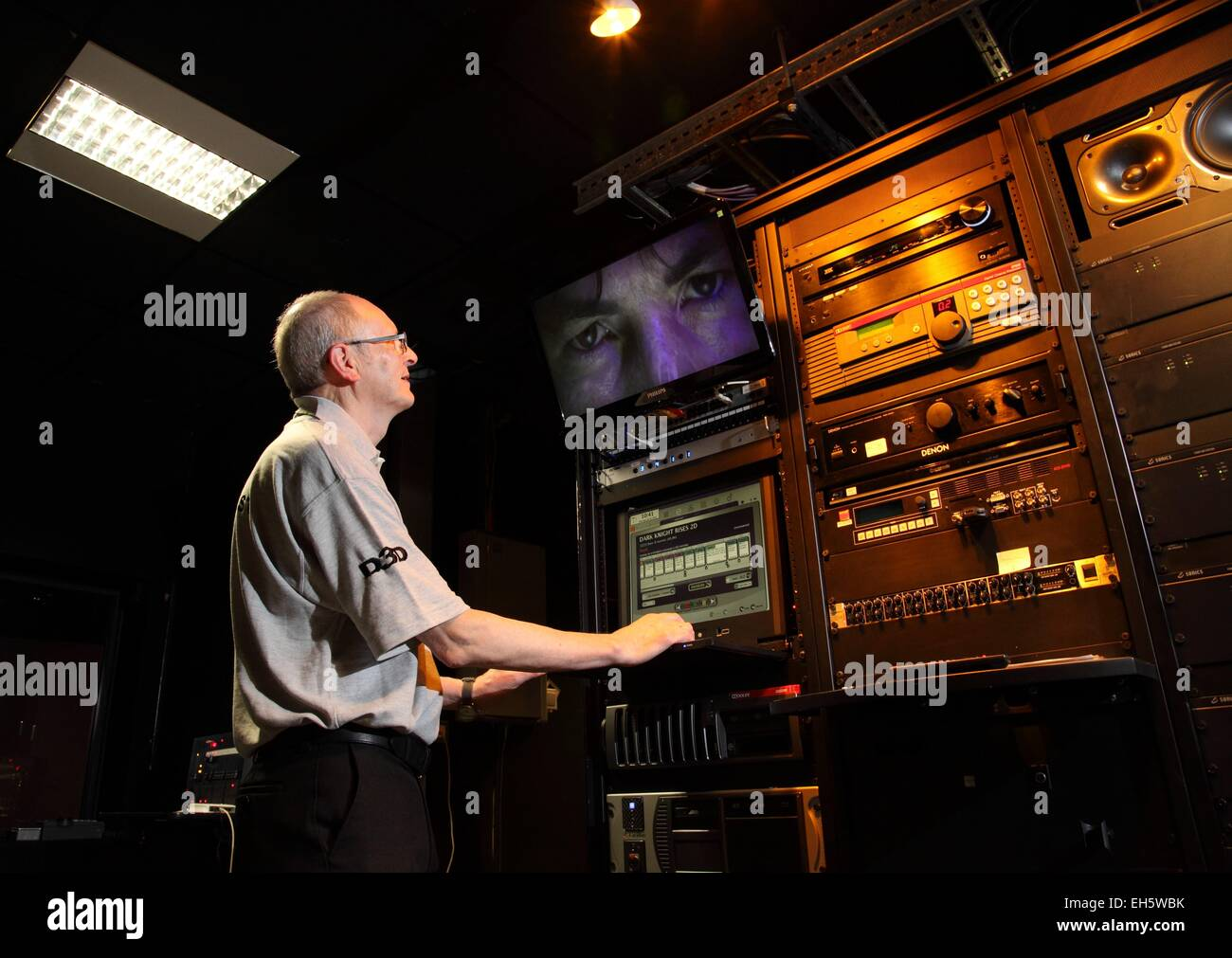 A man at the controls of a cinema projection room Stock Photo