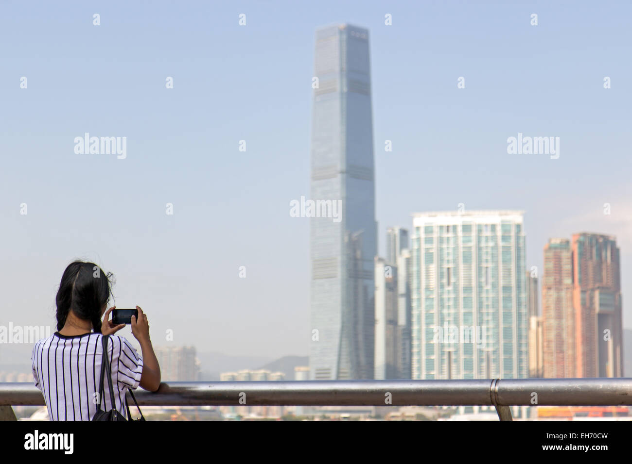 woman on the coast photographs Hong Kong - Stock Image