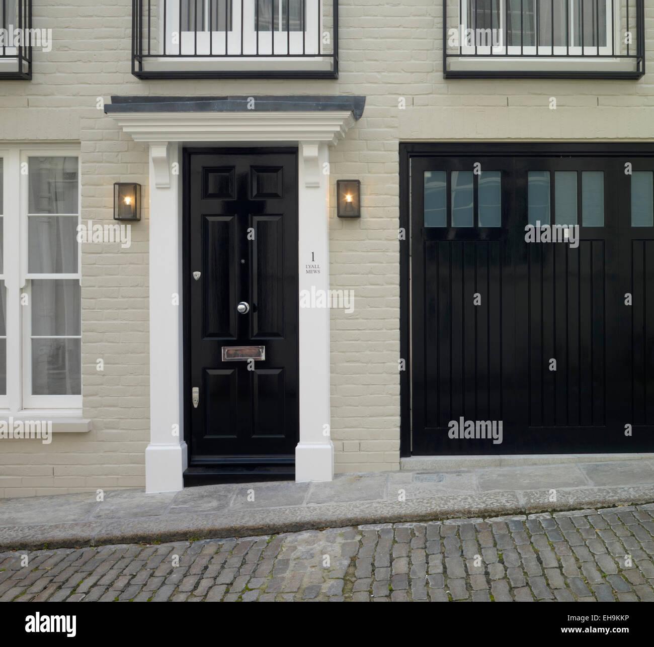 Black Front Door And Garage Door Of Residential House
