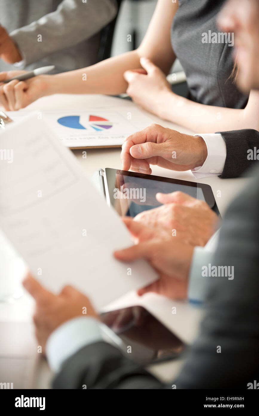 Executives in meeting, cropped - Stock Image