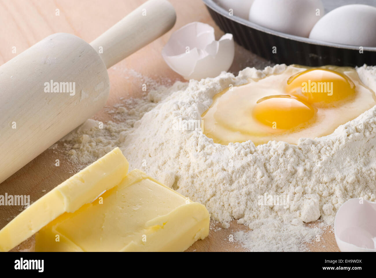 Baking ingredients. Flour, egg and butter. - Stock Image