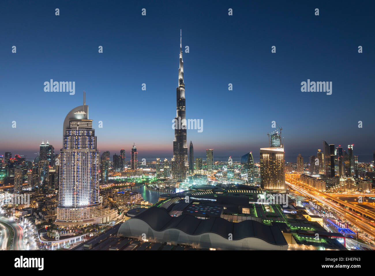 Burj Khalifa , the Dubai Mall and skyline of Downtown Dubai at night in United Arab Emirates - Stock Image