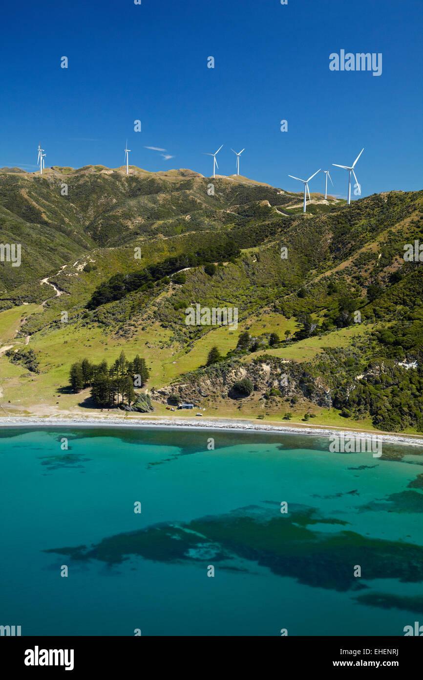 Te Ikaamaru Bay, and Makara Wind Farm (Project West Wind) Wellington, North Island, New Zealand - aerial - Stock Image