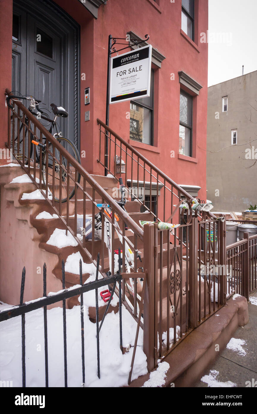 A townhouse is advertised for sale in the Williamsburg neighborhood of Brooklyn in New York on Saturday, March 7, - Stock Image