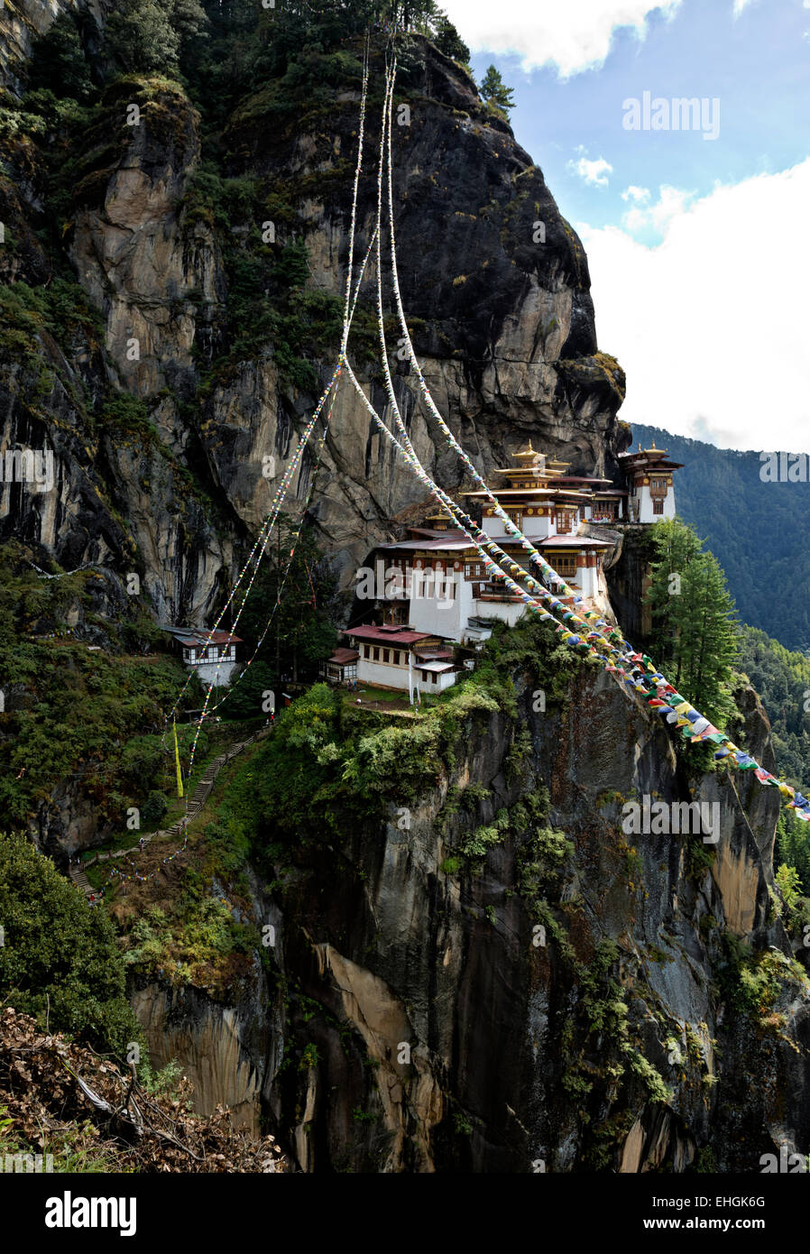 BHUTAN - Prayer flags at Taktshang Goemba, ( Tiger's Nest Monastery), perched on side of cliff high above the - Stock Image