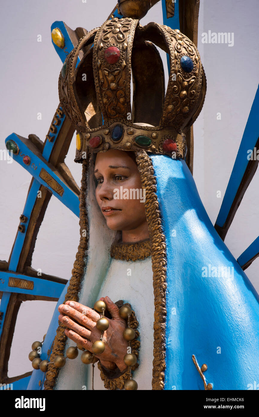 Argentina, Buenos Aires, Recoleta, Churchyard, Our Lady of Pilar devotional figure near door - Stock Image