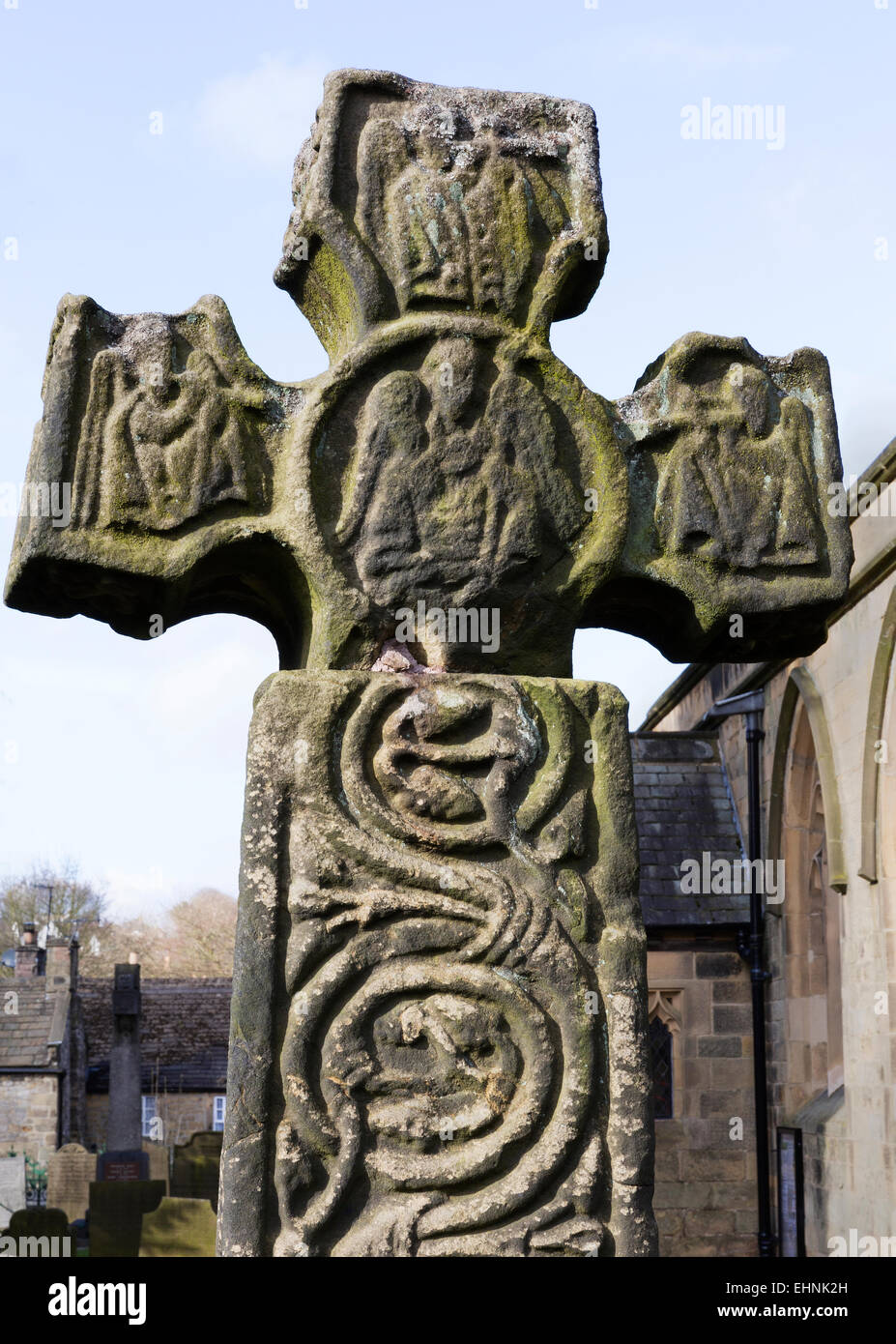 The 8th century Anglo Saxon or Celtic Cross in St Lawrence's churchyard at Eyam in the Derbyshire Peak District - Stock Image