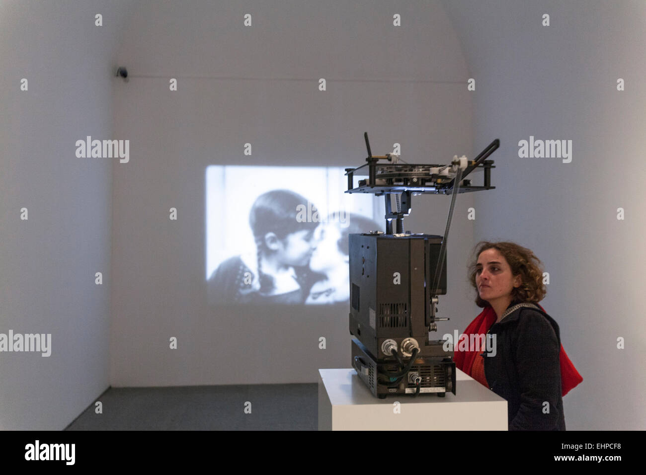 woman-observing-a-film-projector-modern-