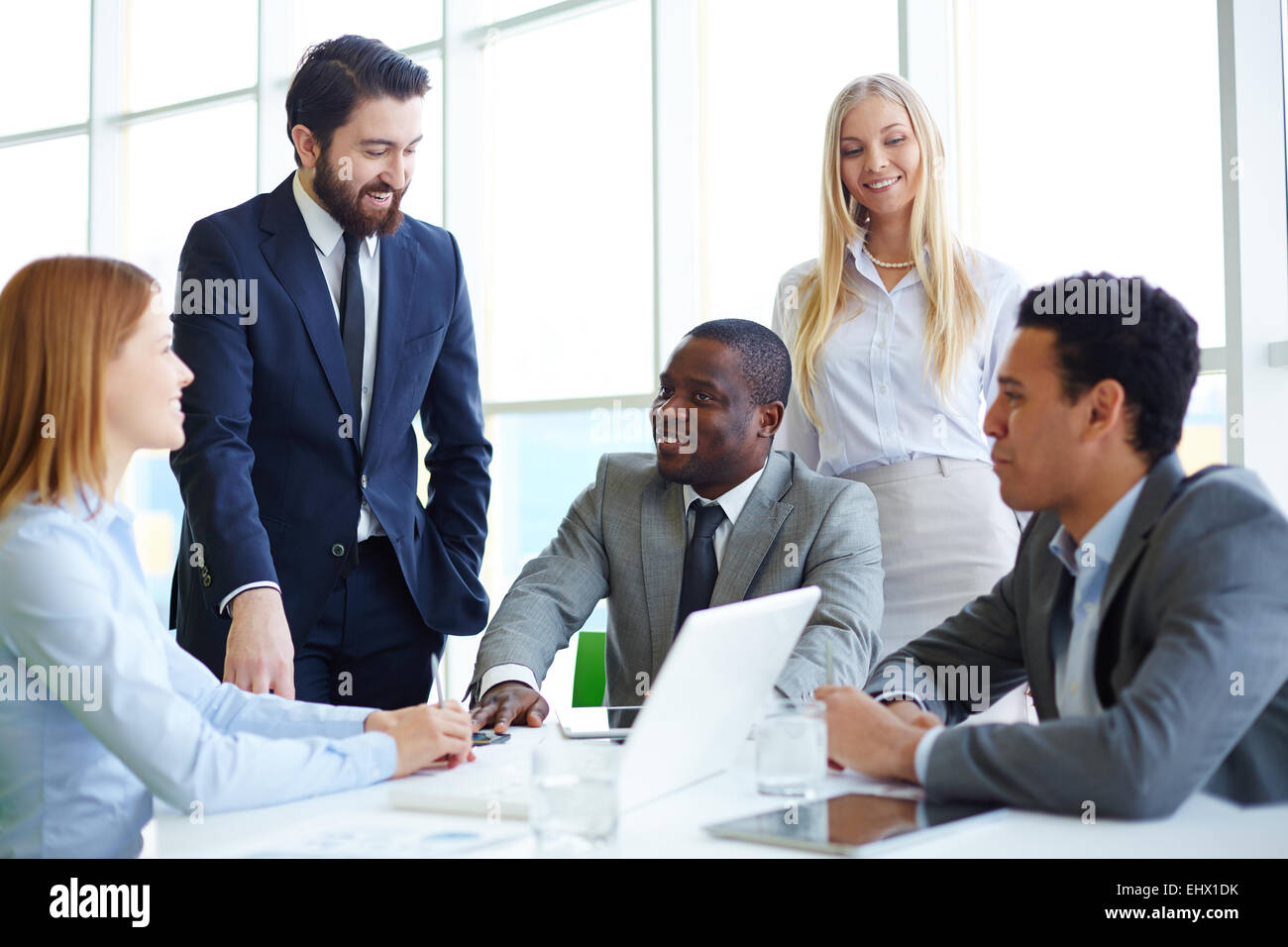 Group of business people gathering and communicating - Stock Image