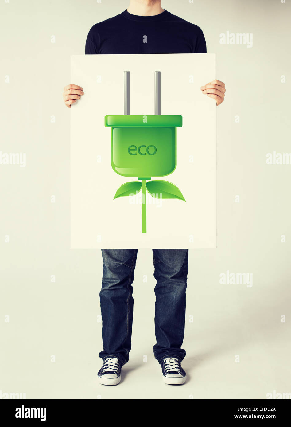 hands holding picture of green electrica ecol plug - Stock Image