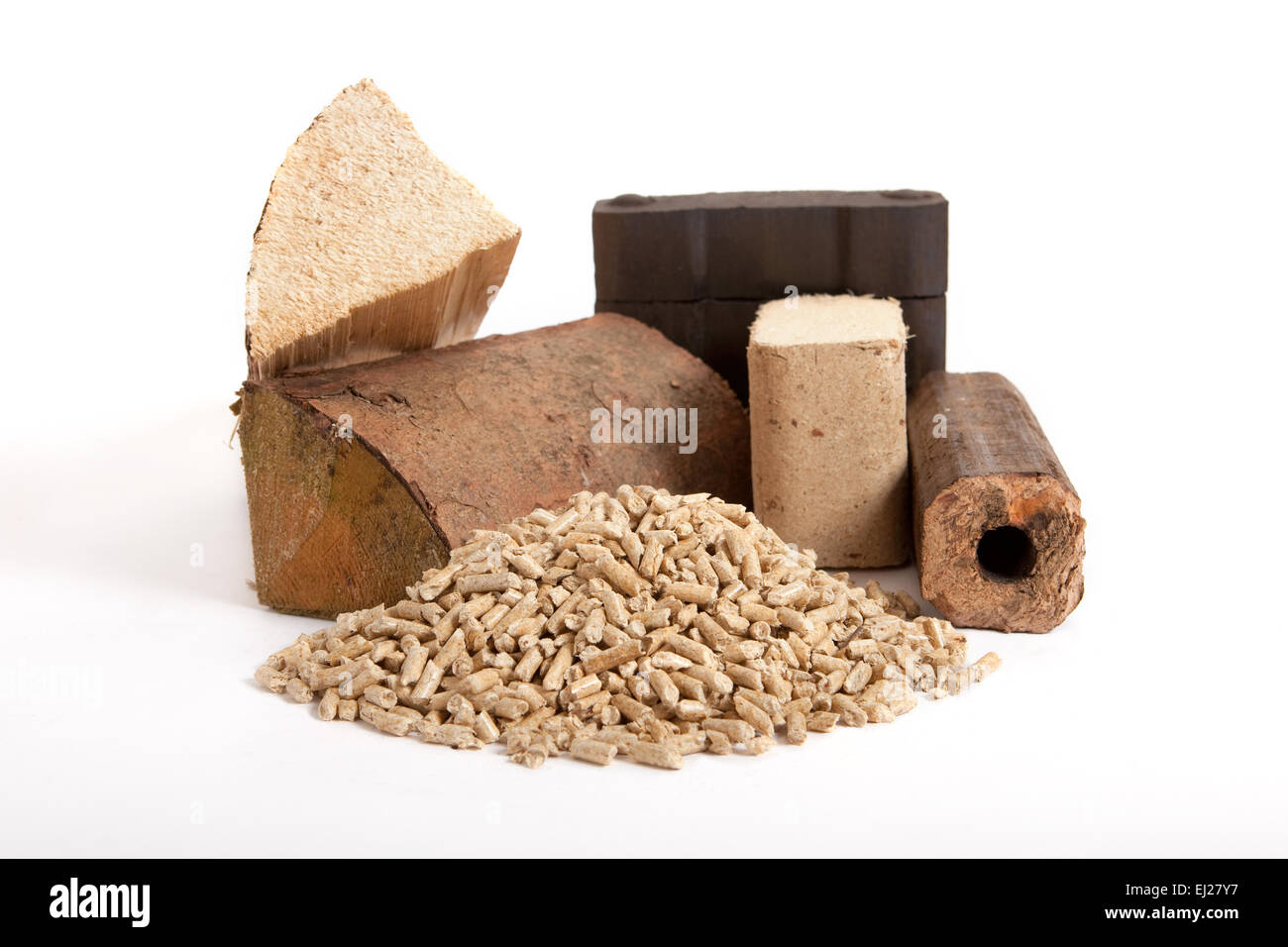 collection of fossil fuels on white background, isolated, firewood, coal, wooden briquettes and oven pellets, - Stock Image