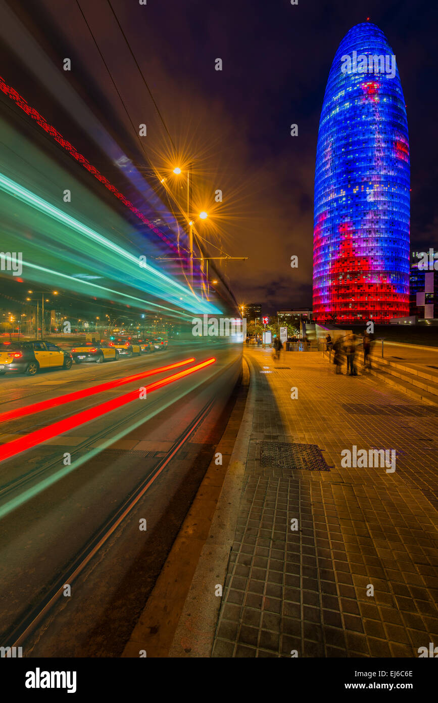 Night view of Torre Agbar skyscraper designed by French architect Jean Nouvel, Barcelona, Catalonia, Spain - Stock Image