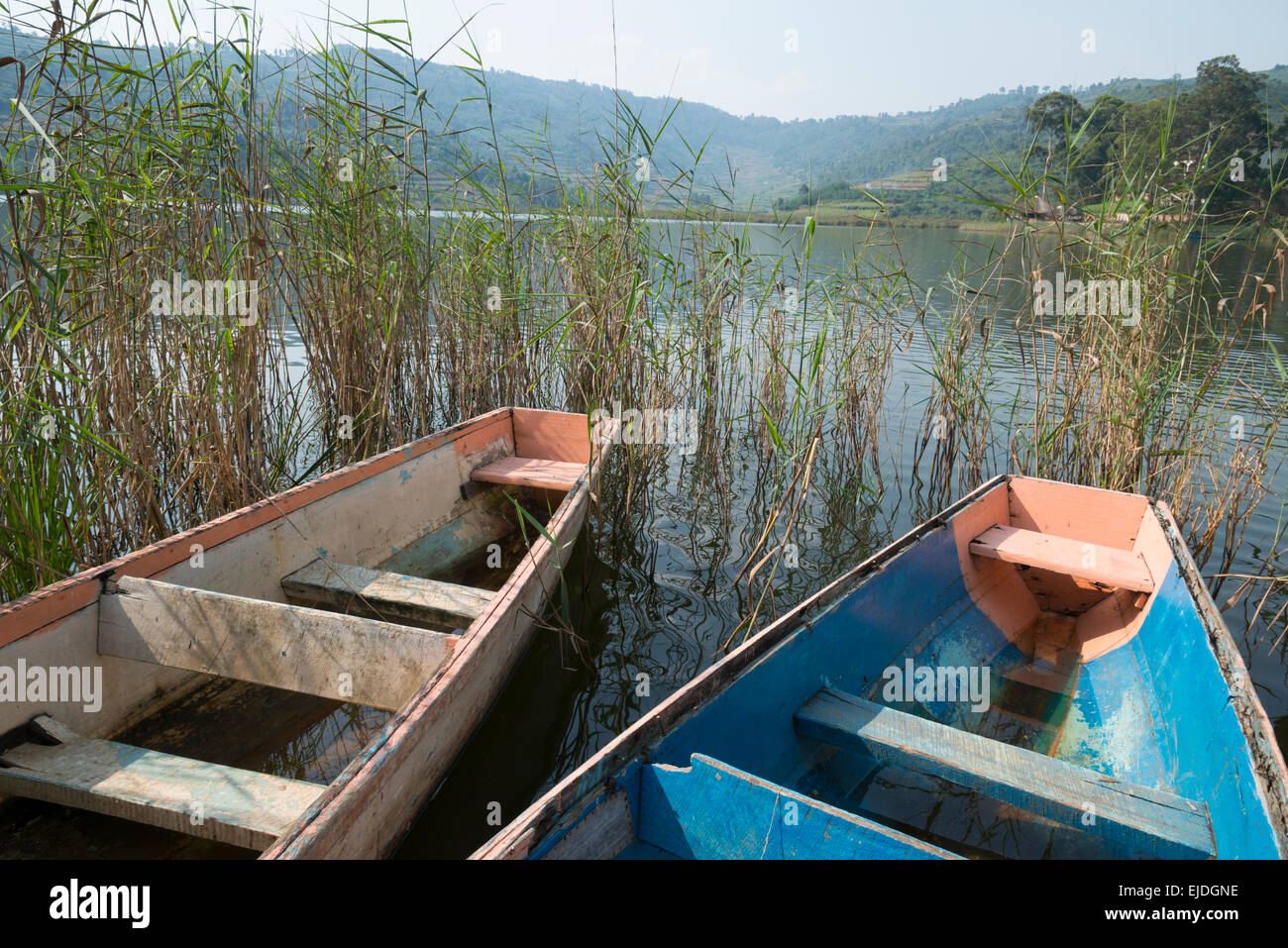 Two dingy boats on lake Bunyonyi. Uganda. - Stock Image