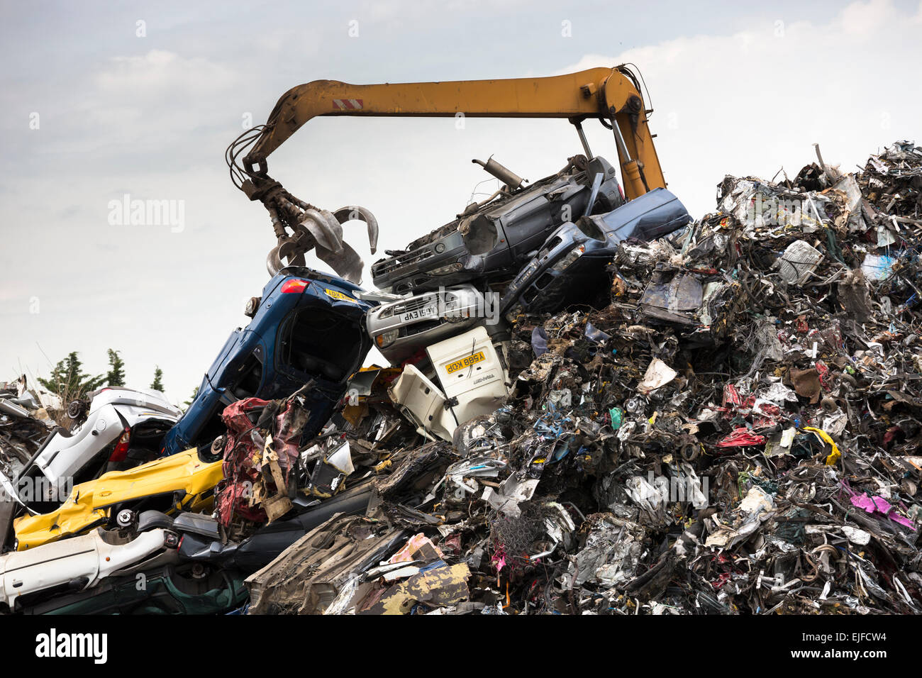Grab machine moving scrap metal, cars and autos for metal recycling ...