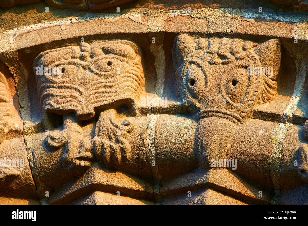 Norman Romanesque relief sculptures of mythical creatures. St Mary & St David Church, Kilpeck Hereford, England - Stock Image