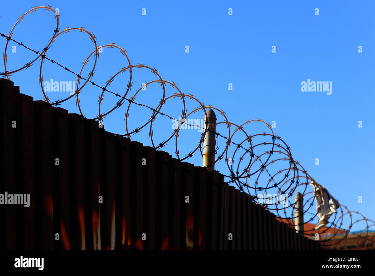 sharp razor wire on top of a metal security fence Stock Photo ...