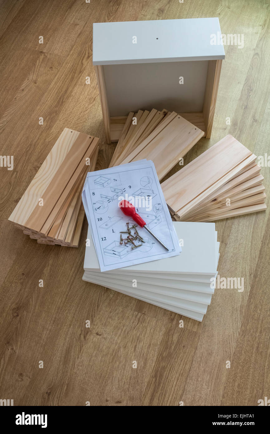 Do It Yourself drawer parts, with instructions for assembly.Stock Photo