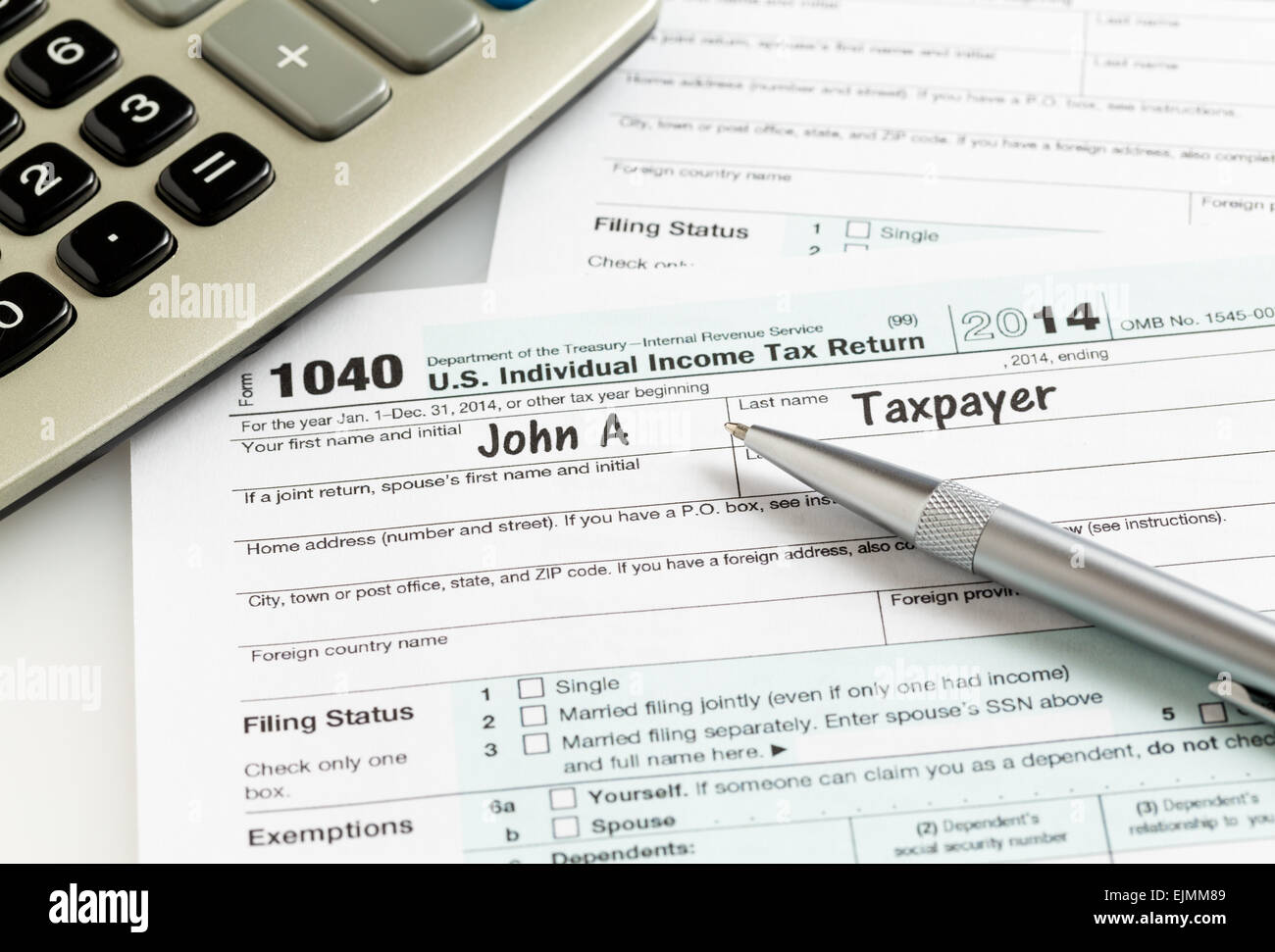 Usa Tax Form 1040 For Year 2014 With A Pen And Calculator Stock