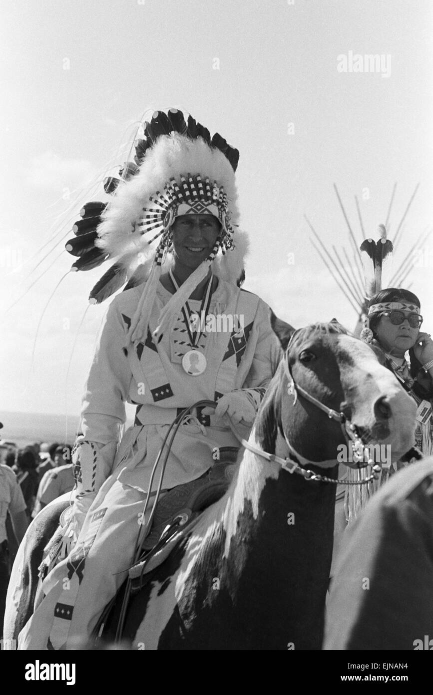 Prince Charles, the Prince of Wales, wearing Indian headdress in Calgary, Alberta during his visit to Canada. 11th - Stock Image