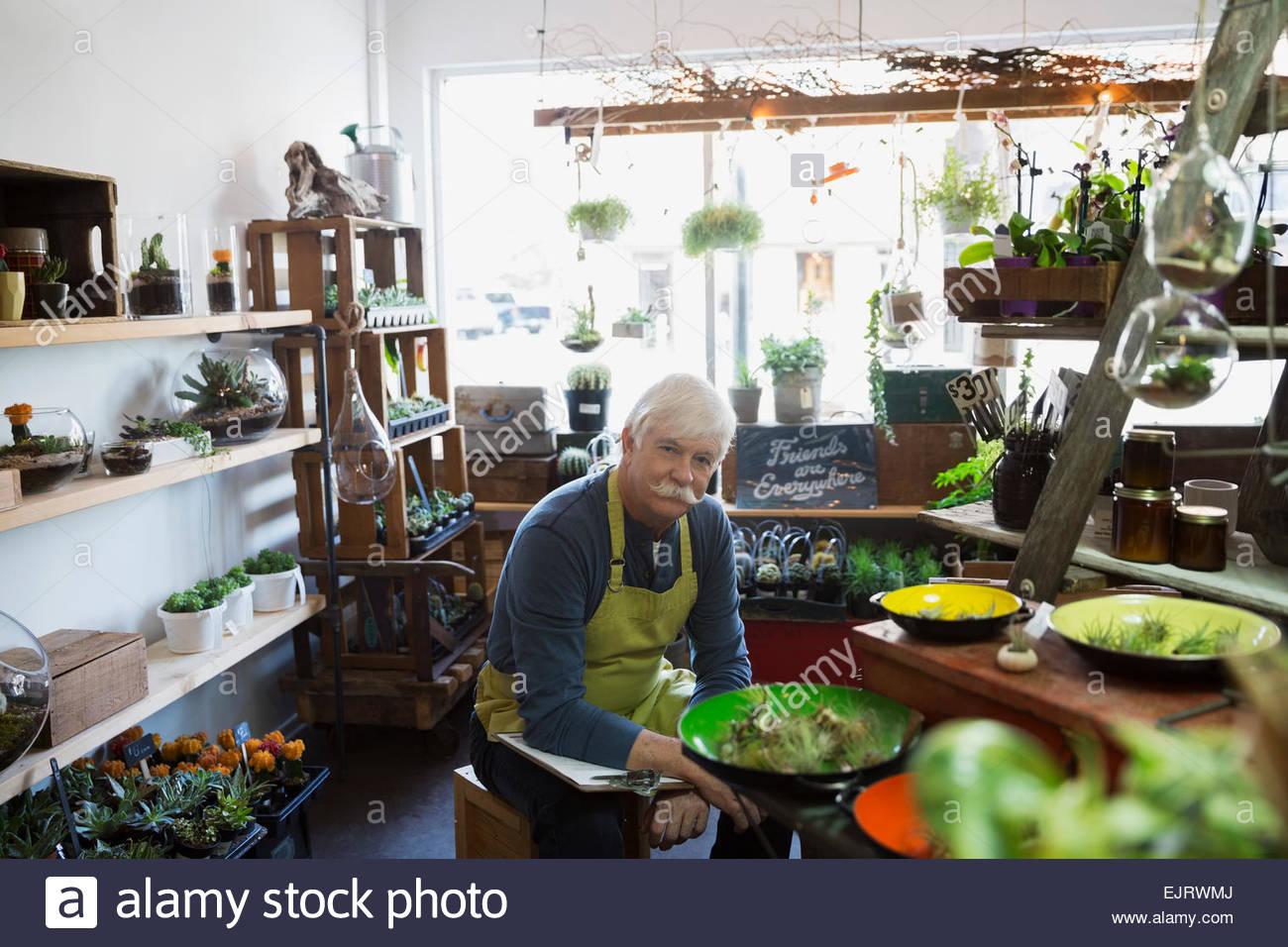 Portrait of terrarium shop owner - Stock Image
