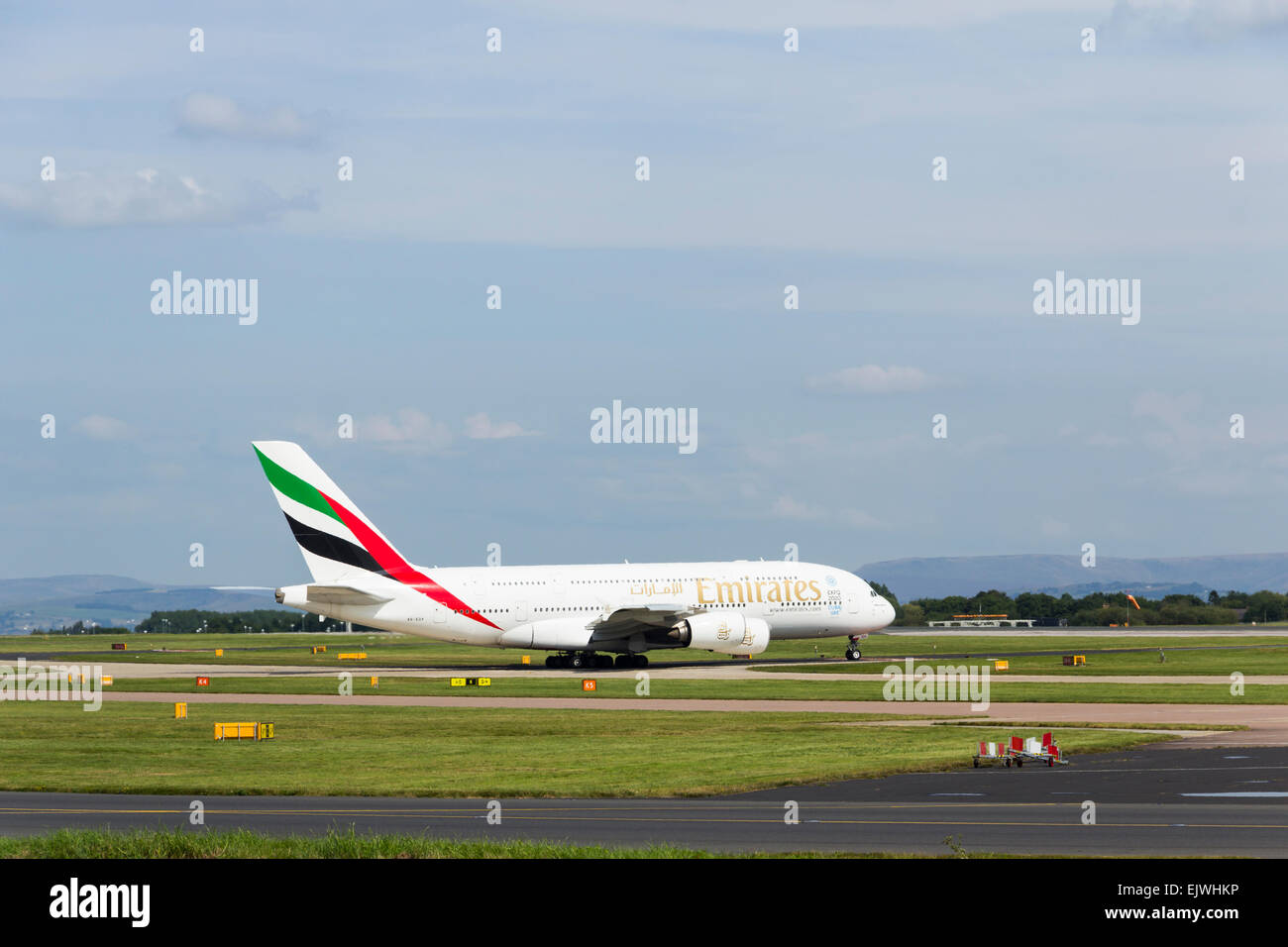 Emirates Airbus A380  aircraft taxiing towards the take-off runway at Manchester airport for  the flight to Dubai. - Stock Image