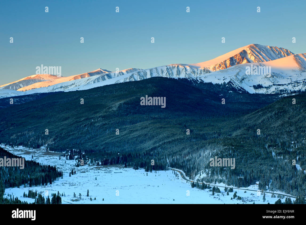 First light on snow-covered Quandary Peak (14,265 ft), Ten Mile Range, and Goose Pasture Tarn, Boreas Pass Trail, - Stock Image