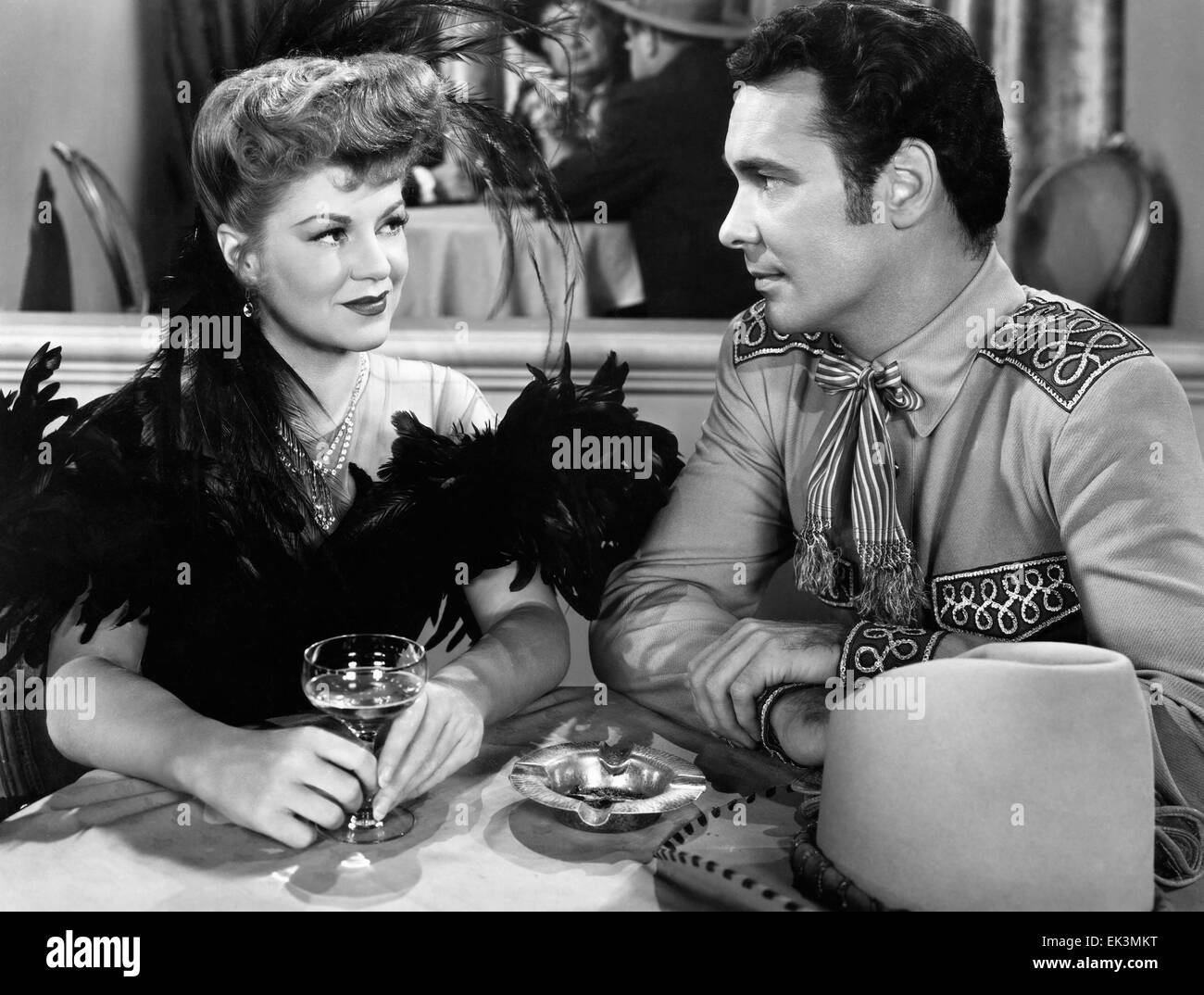 Claire Trevor, Barry Sullivan, on-set of the Film 'The Woman of the Town', 1943 - Stock Image