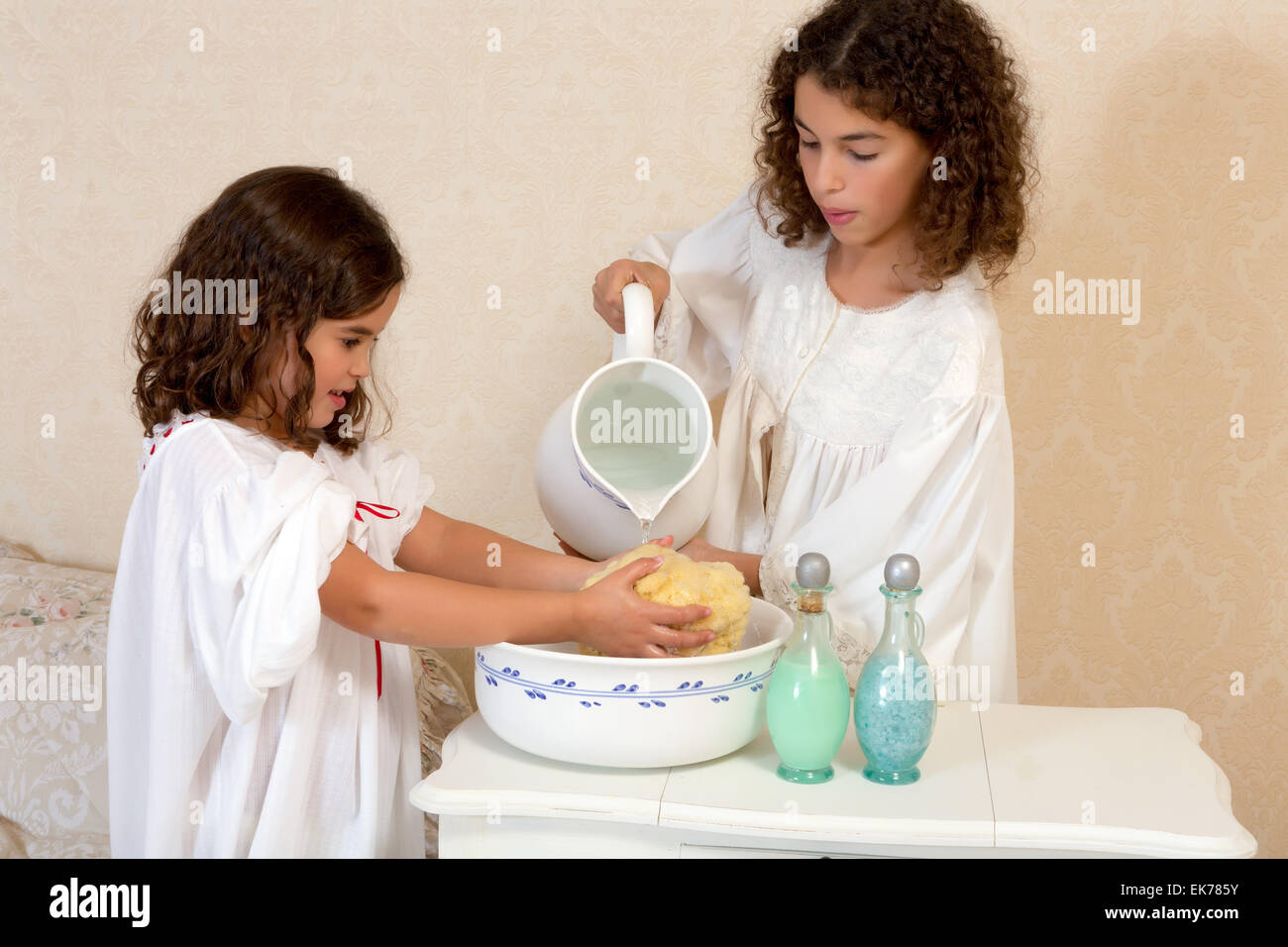 Cute vintage victorian girls in nightgowns washing before bedtime ...