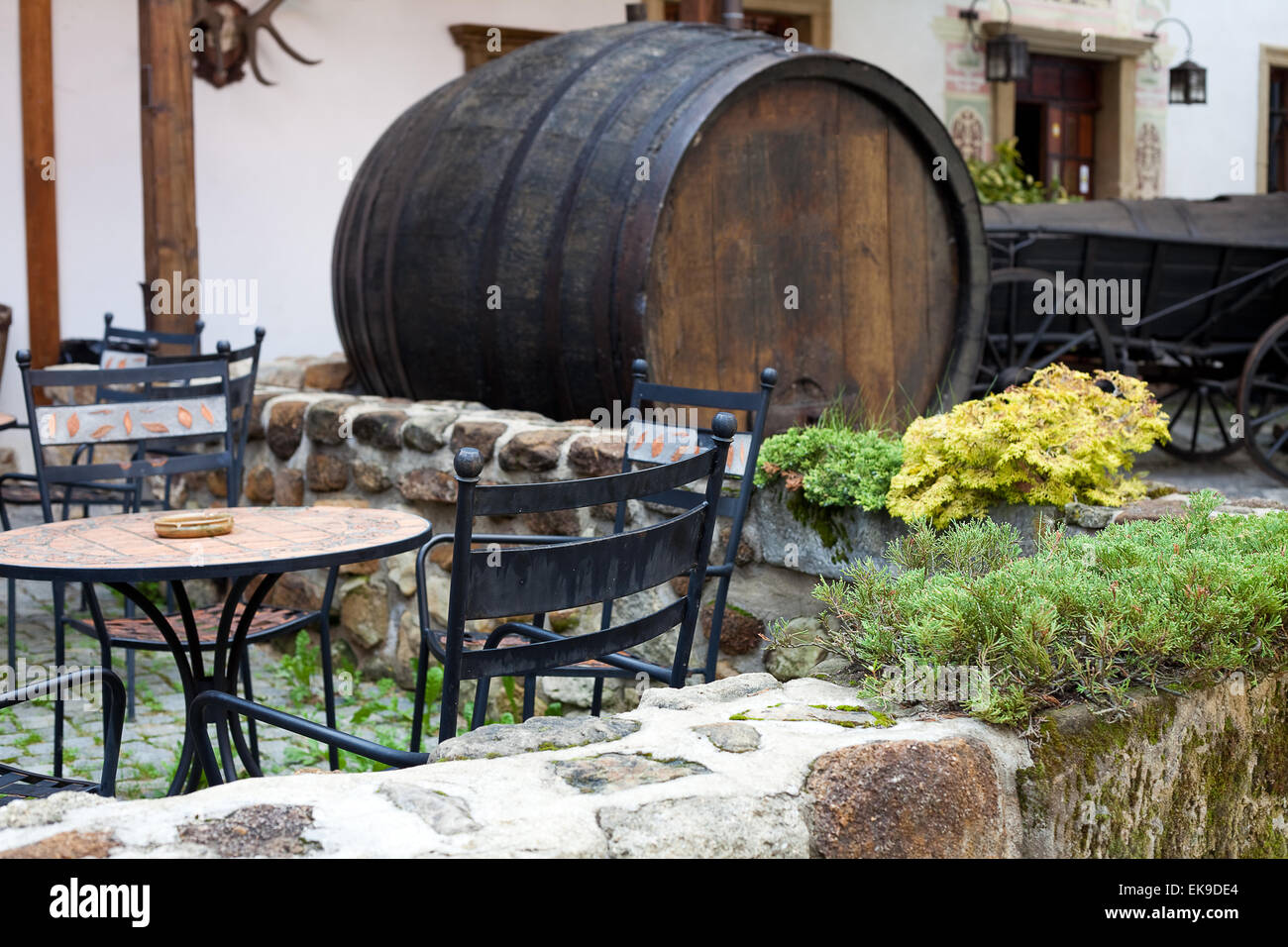 forged furniture cafe and a large beer keg Stock Photo: 80728092 - Alamy