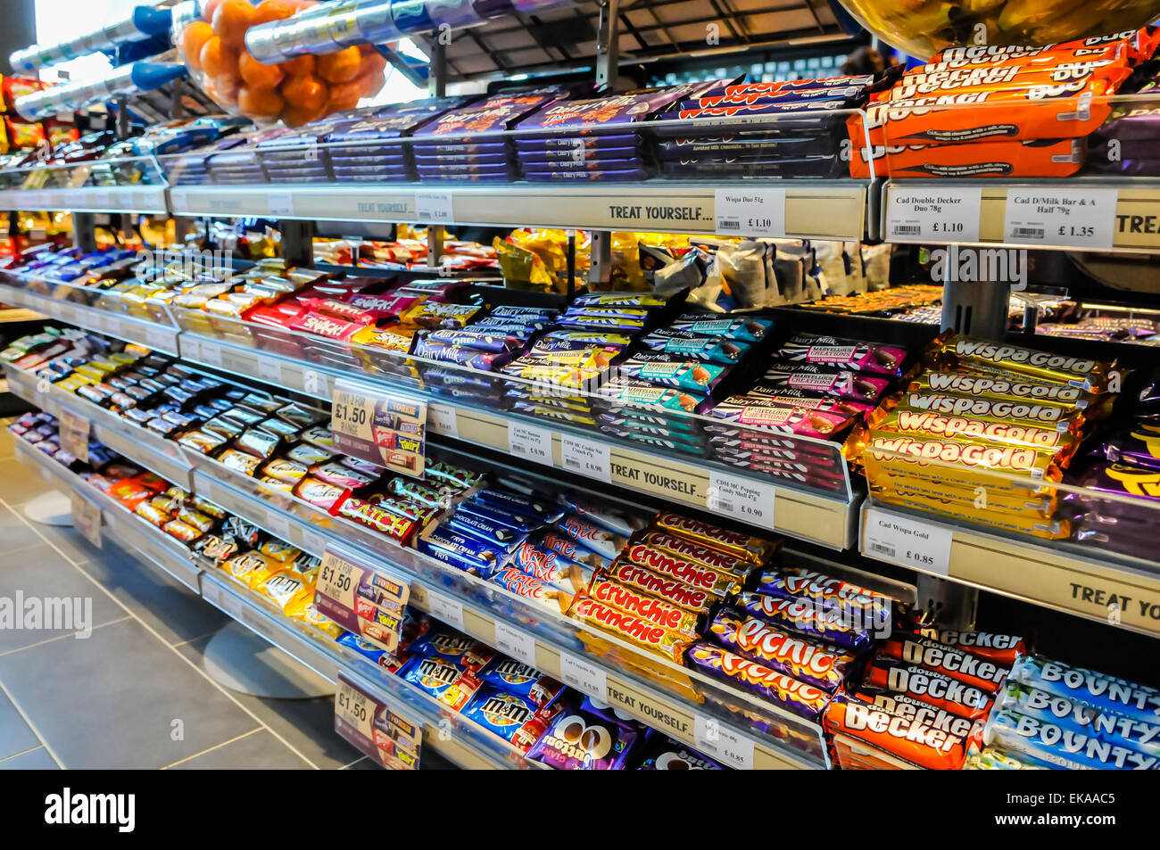 sweets and chocolate bars on sale in a motorway service. Black Bedroom Furniture Sets. Home Design Ideas