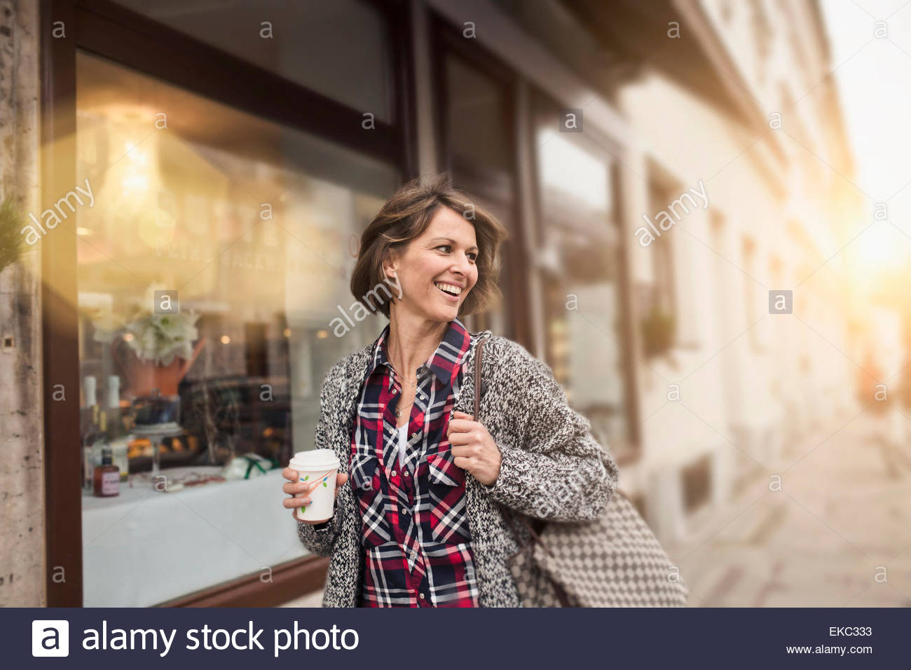 Woman having coffee while shopping - Stock Image