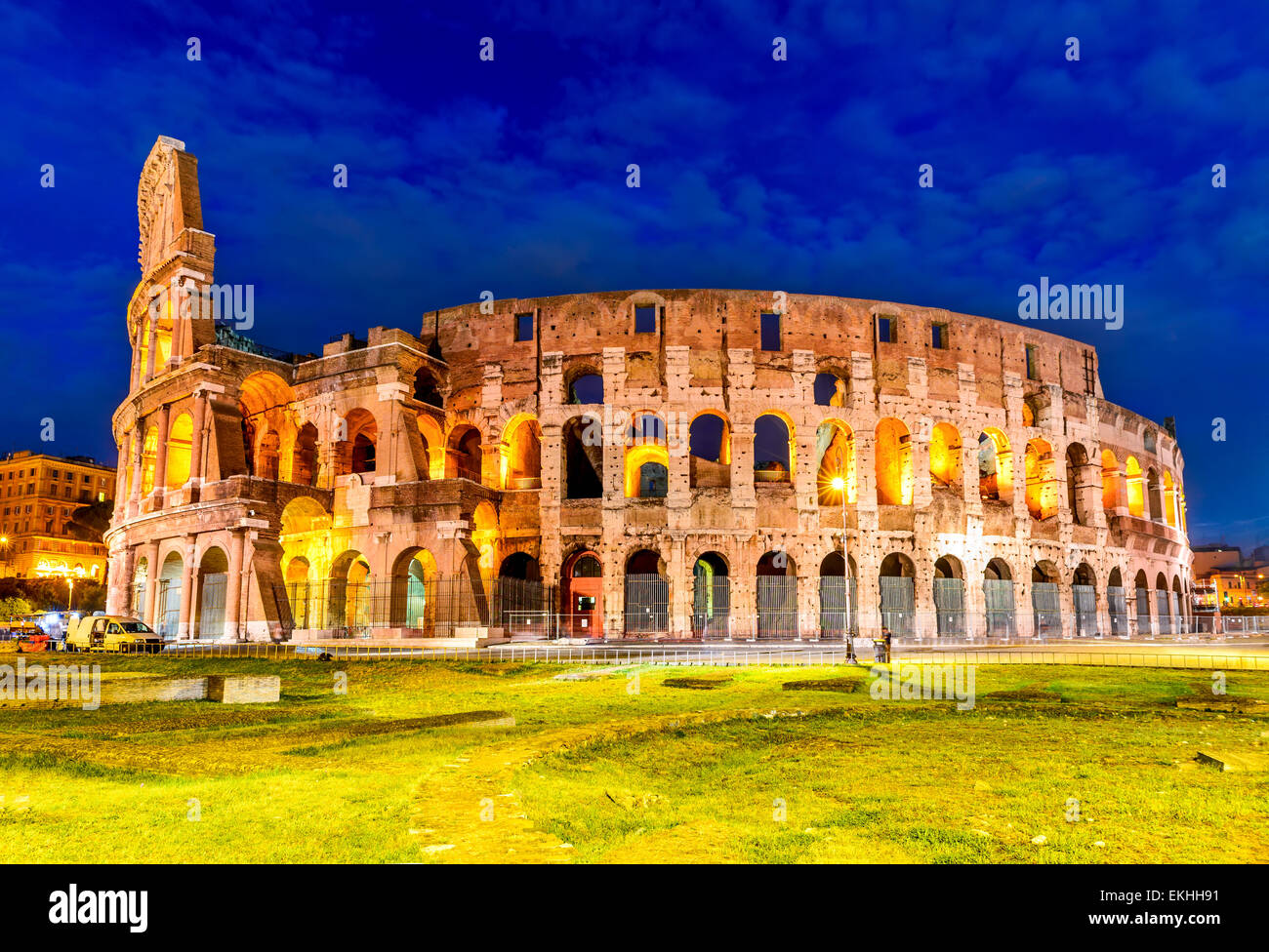 Colosseum, Rome, Italy. Twilight view of Colosseo in Rome, elliptical largest amphitheatre of Roman Empire ancient - Stock Image