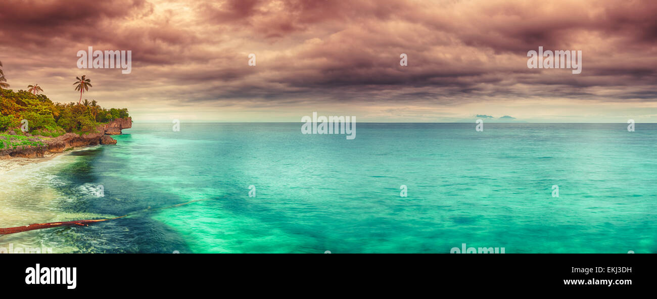 Panorama of a coastline at sunset time. Philippines - Stock Image