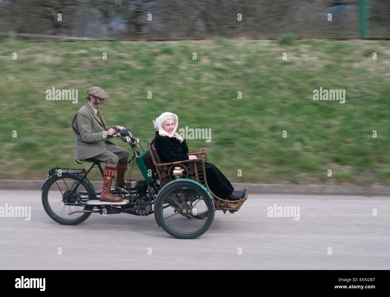 older-couple-riding-a-motor-tandem-tricy
