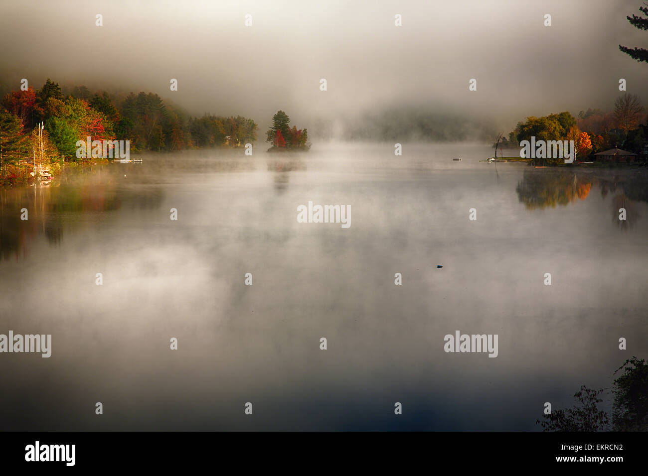 High Angle View of a Lake with Morning Fog During Fall, Knapp Brook Pond, Vermont - Stock Image