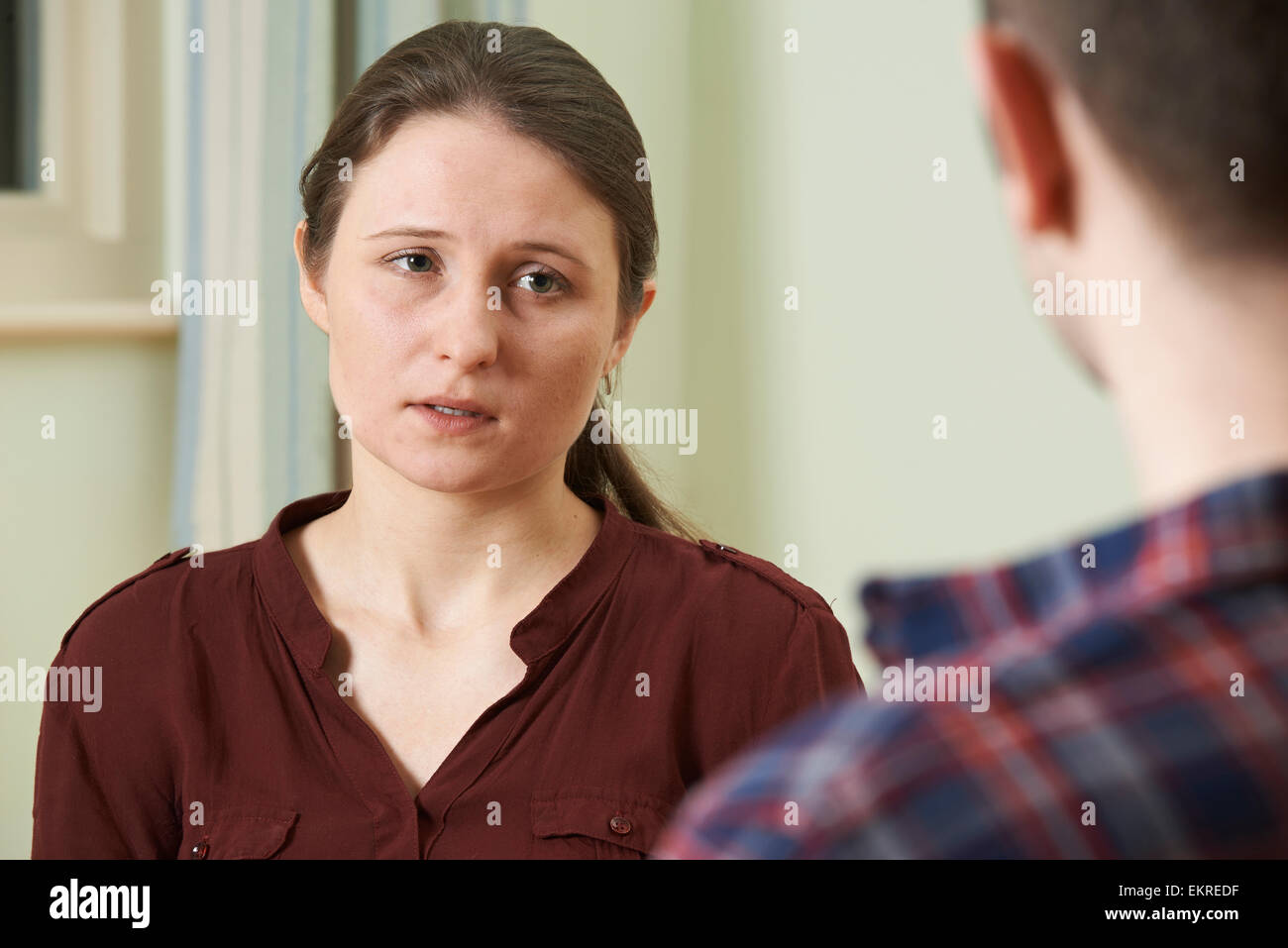 Depressed Young Woman Talking To Counsellor - Stock Image