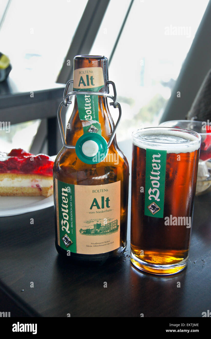 A printed glass  and bottle of Bollen Altbier on a bar, Düsseldorf, Nordrhein-Westfalen, Germany Stock Photo