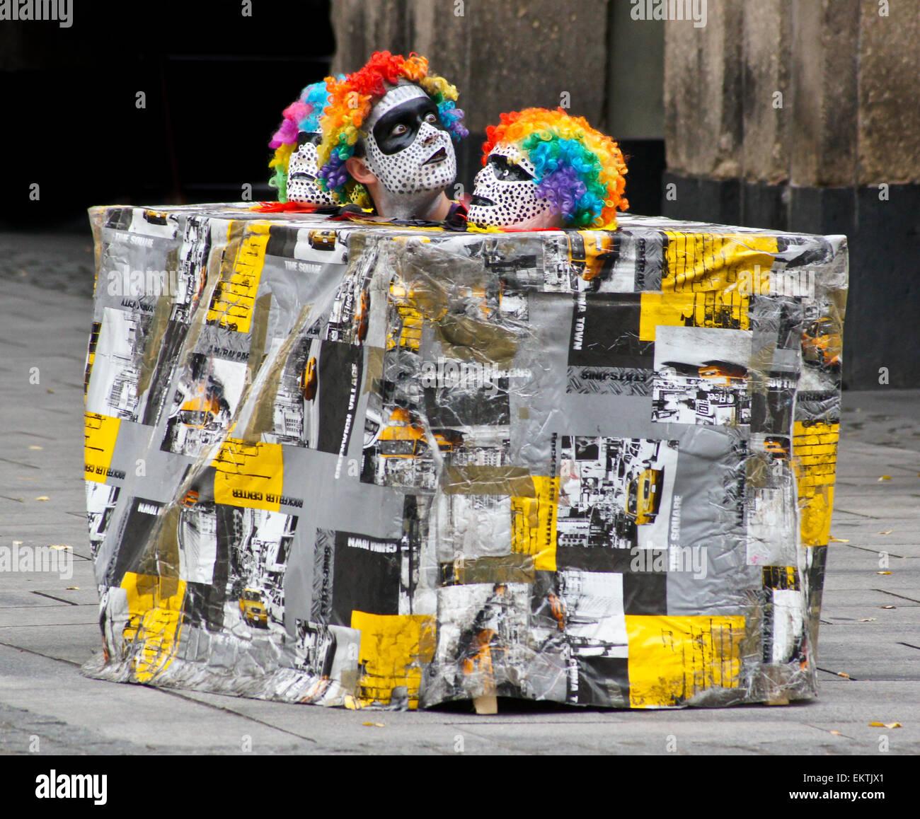 a-mime-artist-and-street-entertainer-in-a-box-dsseldorf-nordrhein-EKTJX1.jpg